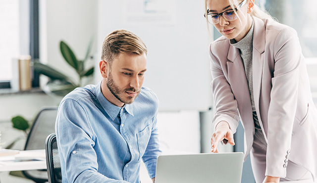 man and woman discussing financial paln