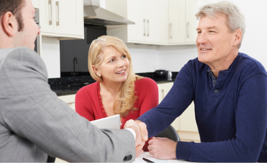 Couple meeting with an equity release broker